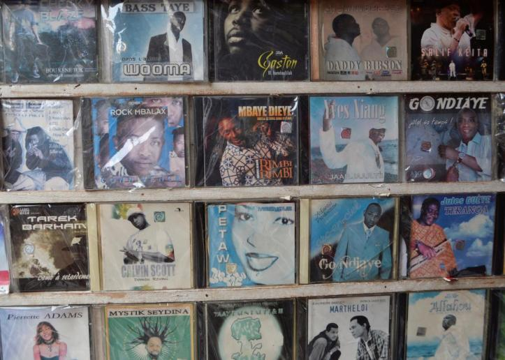 CDs for sale are displayed at a street market in Dakar