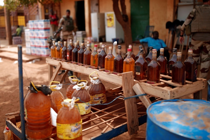 Bottles filled with petrol are seen at a stand as French soldiers conduct a CIMIC (Civil-Military Co-operation) patrol during the regional anti-insurgent Operation Barkhane in Gao