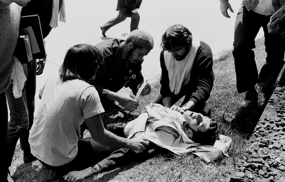 Wounded Kent State student John Cleary is attended to by other s