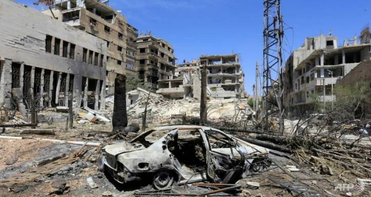 a-general-view-shows-destruction-in-douma-on-the-outskirts-of-damascus-on-april-16-2018-during-an-organised-media-tour-after-the-syrian-army-declared-that-all-anti-regime-forces-left-eas