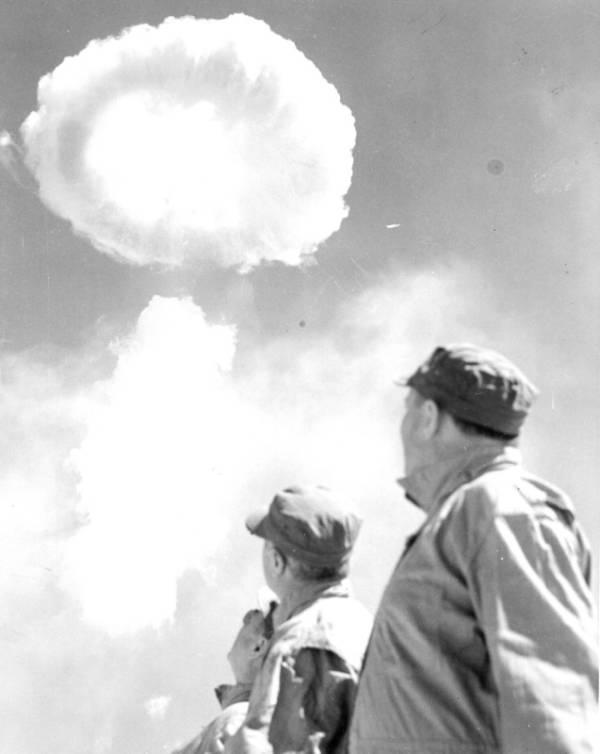 men-watching-mushroom-cloud