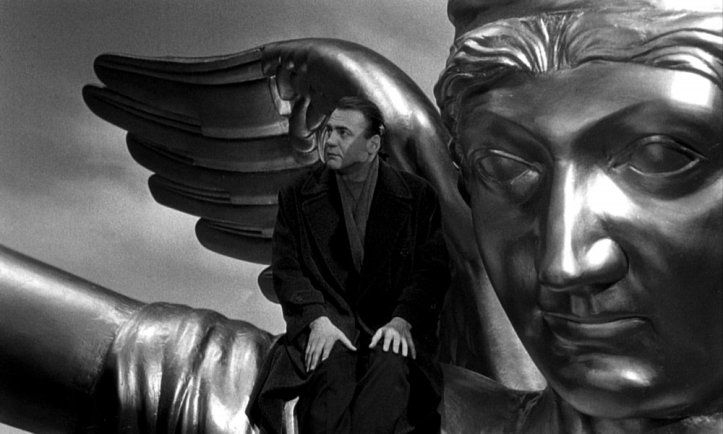 wings-of-desire-1987-004-bruno-ganz-angel-statue-head (1)